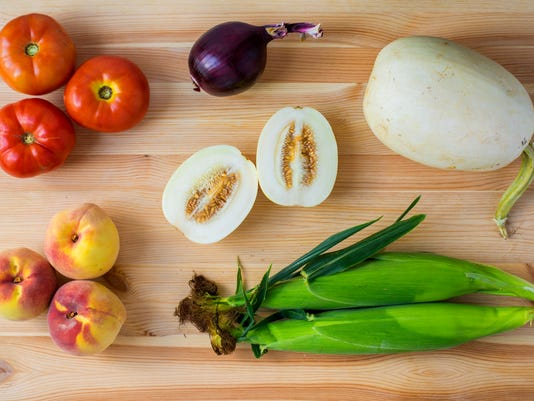 Clockwise, from top left: Tomatoes (3 of 4), red onion, sprite melon (split), spaghetti squash, sweet corn (2 of 4) and peaches (3 of 4). Photo by Jeff Lautenberger.