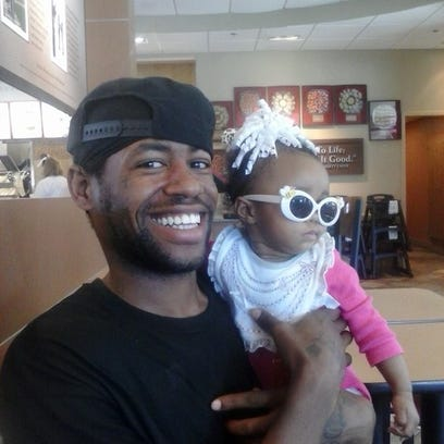 Joseph Manning, pictured with his niece, was found unresponsive in the Lansing Detention Center in 2013. His family filed a federal civil lawsuit Nov. 25, alleging jail staff and police officers neglected his medical needs.