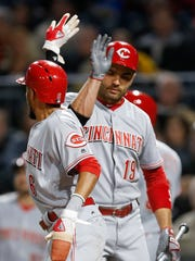 Cincinnati Reds' Billy Hamilton is greeted by Joey