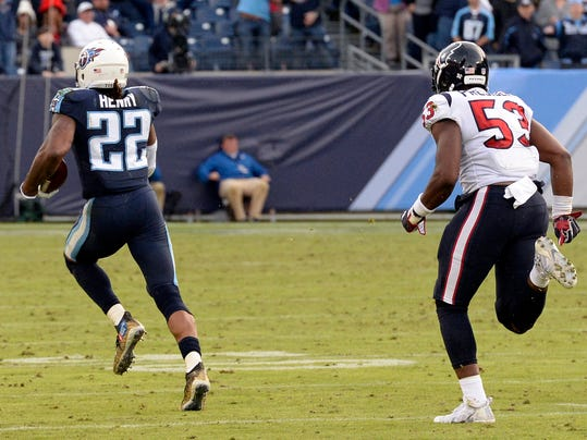 FILE - In this Sunday, Dec. 3, 2017, file photo, Tennessee Titans running back Derrick Henry (22) leaves Houston Texans outside linebacker Gimel President (53) behind as he runs 75-yards for a touchdown in the fourth quarter of an NFL football game in Nashville, Tenn. Henry says he didn't want to be caught from behind. Well, nobody caught the Tennessee running back as the Heisman Trophy broke loose for a 75-yard run and was clocked at 21.64 mph, tied for the fifth-fastest ball carrier this season. (AP Photo/Mark Zaleski, File)