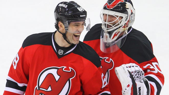 New Jersey Devils right wing Jaromir Jagr and goalie Martin Brodeur celebrate the Devils 5-2 win over the Ottawa Senators at the Prudential Center.