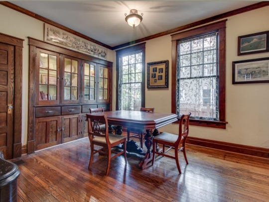 The bungalow features warm chestnut woodwork throughout.