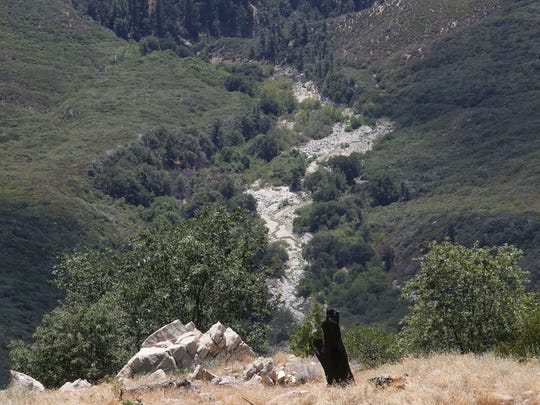 Seen from far away, a small amount of water can be seen flowing in the east fork of Strawberry Creek in the San Bernardino National Forest, August 28. 2017.