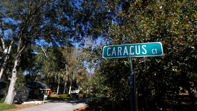 The Caracus Court street sign at an intersection that is the only entrance into the dead-end street where Leon County Deputy Christopher Smith was gunned down by Curtis Wade Holley after responding to a 911 call on Nov. 23, 2014.