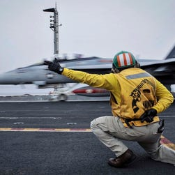 In this Wednesday, April 15, 2015 image released by the U.S. Navy, a shooter launches an F/A-18F Super Hornet, assigned to the Red Rippers of Strike Fighter Attack Squadron 11, off the flight deck aboard Nimitz-class aircraft carrier USS Theodore Roosevelt in the Fifth Fleet area of operations. he U.S. Navy has dispatched USS Theodore Roosevelt toward the waters off Yemen to join other American ships prepared to intercept any Iranian vessels carrying weapons to Houthi rebels, U.S. officials said on Monday.