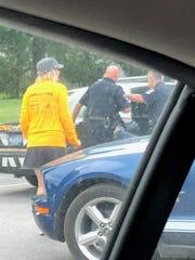 Southwestern Regional Police arrest a man outside a