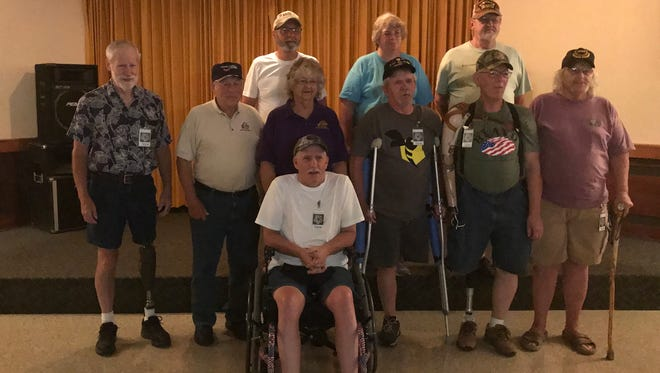 The Mountain Home Elks Lodge recently hosted dinner for 35 disabled veterans that had been on a kayak outing arranged by the Wake Foundation. The Wake Foundation mission is to work closely with national veteran support organizations to provide facilities and logistical support for outdoor rehabilitative programs and events for Veterans. Shown are: (second and third from left on first row) Elk members Albert and Patty Underwood, along with some of the Veterans.