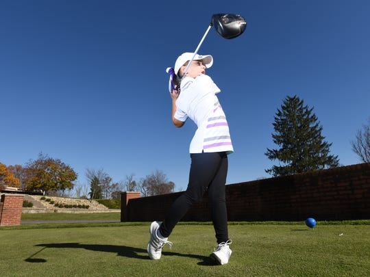 Mia Hammond, 8, of Crooksville, tees off at Zanesville Country Club prior to playing a recent practice round. Hammond earned five wins playing on the U.S. Kids Golf Tours in North Carolina and West Virginia.