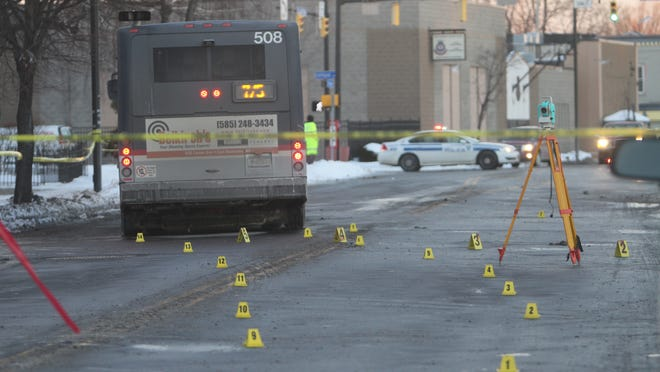 File photo: Police investigate a bus crash that killed a cyclist on Jan. 30, 2014.