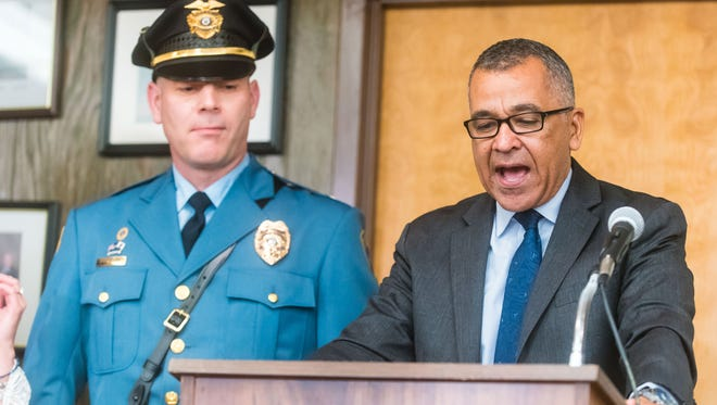 """Mayor Michael Santiago (right) and newly promoted police Capt. Harrison """"Harry"""" Cranmer during March 21, 2017 meeting."""