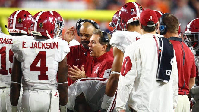 Alabama coach Nick Saban is shown here talking to the defense, including preseason All-American Eddie Jackson.