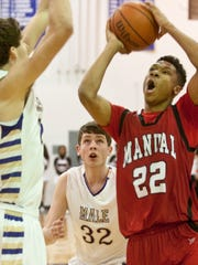 Incoming Louisville guard Dwayne Sutton pictured in high school as Manual took on Male.