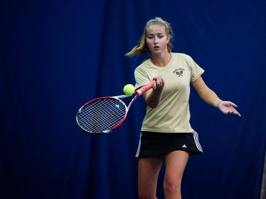 Delone Catholic's Ellie Neudecker returns against York Suburban's Liv Pindzola on Saturday Oct. 8, 2016 at Wisehaven Tennis Center in York during the class 2A YAIAA individual tennis championship match.