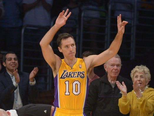 Lakers guard Steve Nash  acknowledges the crowd after
