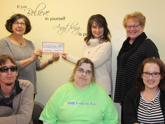 Members of the Alpha Delta Kappa sorority give Trista