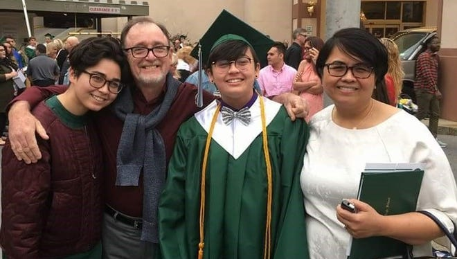 Sharon Grey Devlin graduated from Spackenkill High School in Poughkeepsie New York on June 23. Sharon has been accepted to Wellsley College Massachusetts and will major in biochemistry and music theory. She is the daughter of Michael and Thelma Devlin, formerly of Dededo. Pictured from left: Michelle, sister; Michael, Sharon and Thelma.