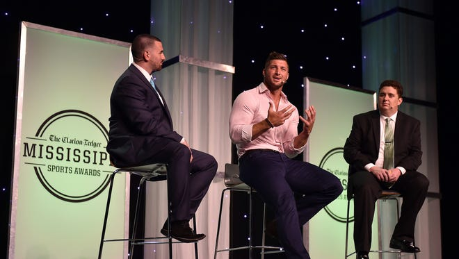 Tim Tebow, center, chats with Clarion-Ledger sports reporter Will Sammon, left, and sports editor Hugh Kellenberger on stage Thursday night during the Best of MS Preps award banquet at the Jackson Convention Center.