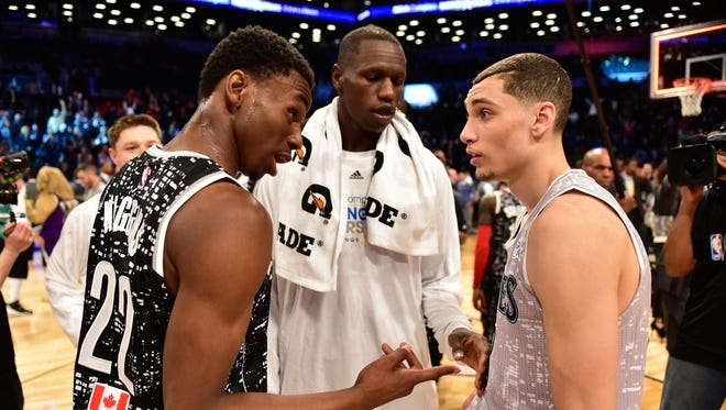 Andrew Wiggins, left, talks to Gorgui Dieng, middle, and Zach LaVine after the Rising Stars Challenge at Barclays Center.