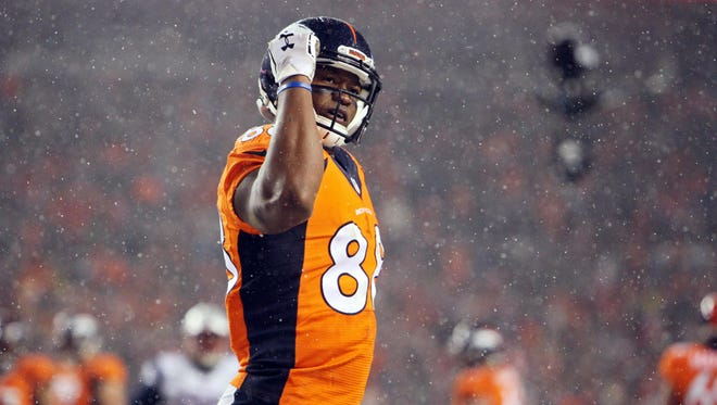 Denver Broncos wide receiver Demaryius Thomas (88) reacts during the second half against the New England Patriots at Sports Authority Field at Mile High.