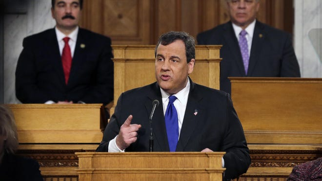 New Jersey Gov. Chris Christie, center, delivers his budget at the Statehouse, Tuesday, Feb. 16, 2016, in Trenton, N.J.
