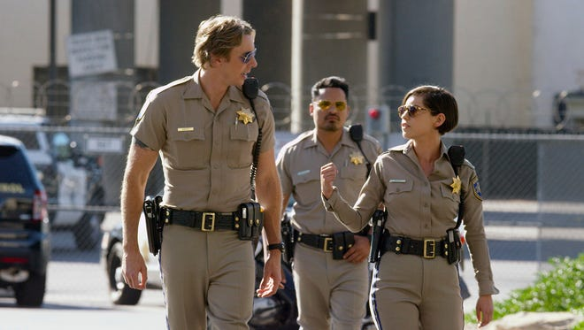 """This image released by Warner Bros. Pictures shows Dax Shepard, from left, Michael Pena and Rosa Salazar in a scene from """"CHiPS."""""""