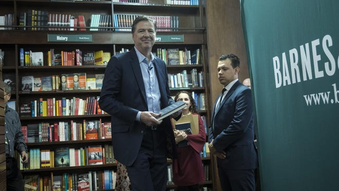 """Former FBI Director James Comey arrives to speak about his new book """"A Higher Loyalty: Truth, Lies, and Leadership"""" at Barnes & Noble bookstore, April 18, 2018 in New York City."""