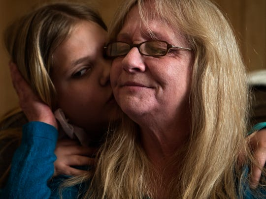 "Granddaughter Sadie Gross, 9, hugs Tammy Wise after she tears up discussing the family's living situation in Pleasant Ridge. ""We were going to come here and finish our life off together,"" Tammy said. ""We thought we were going to be here until he passes on."" March 15, 2017"