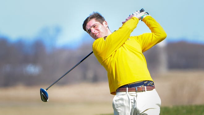 Marquette's Harrison Ott hits his drive on No. 2 during the Washington County boys golf invitational Saturday at the Washington County Golf Course in Hartford. Ott shot a 4-under-par 68 to capture medalist honors and lead the Hilltoppers to the title.