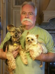 New Albany native Bob Receveur, now in Knoxville, Tenn., has attended every Indy 500 since 1965. He parks his RV in the best spot in the American Legion lot on Georgetown Road.  Dogs are, from left, Brandy and Thumbelina.