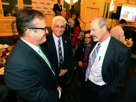 Alejandro Oscar Ramirez Ruiz, left, president of the