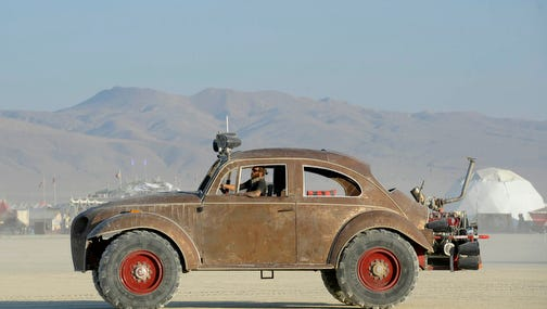 Mutant vehicles line up Sunday, Aug. 28, 2016 to be registered at the DMV on the playa during Burning Man.