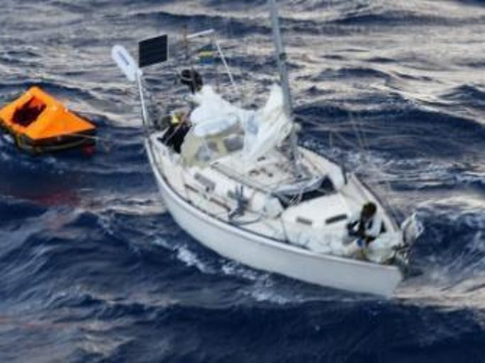 Two people from the sailboat Bull took to their life raft when the boat began taking on water near Bermuda on Saturday. They were rescued by the ship Crown Sapphire.