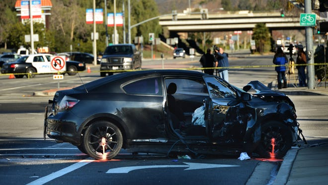 A Scion coupe remains in place hours after a crash that killed a Los Angles police officer early Jan. 1 at Cochran Street and Sycamore Drive in Simi Valley.