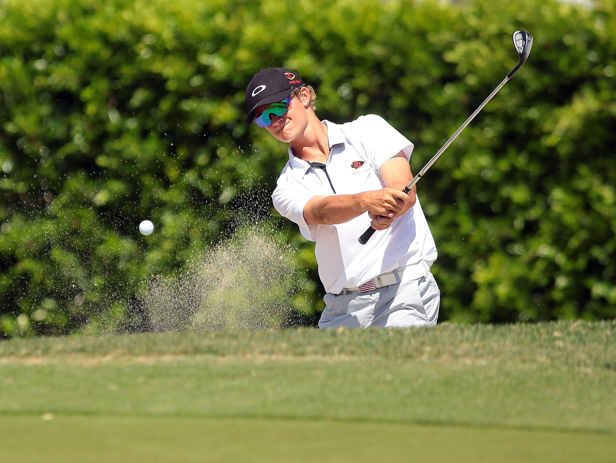 Palm Desert's Jake Vincent blasts out of a greenside bunker on the eighth hole during the Desert Valley League boys golf individual championship tournament Thursday, April 28, 2016, on the North Course at Indian Canyons Golf Resort in Palm Springs, Calif.