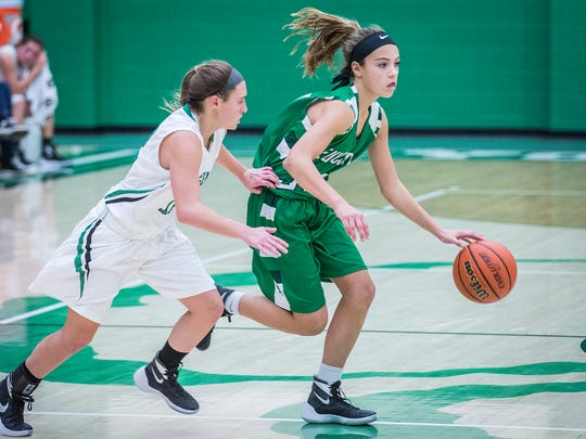 New Castle's Cameron Tabor slips away from Yorktown's defense during their game at Yorktown High School Saturday, Dec. 5, 2015.