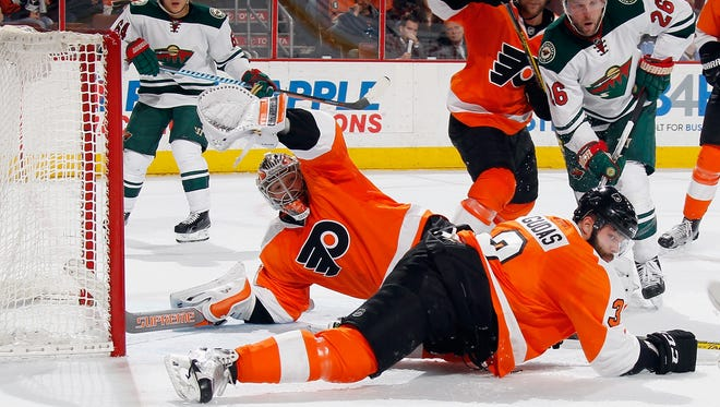 Michal Neuvirth made a tremendous save with three seconds left to ensure the Flyers a 3-2 win Thursday.