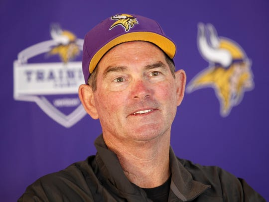 Minnesota Vikings head coach Mike Zimmer answers questions during the first day of training camp on Friday at Minnesota State University in Mankato.