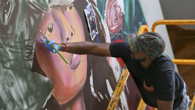 Miami artist Nate Dee works on a mural inside the renovated Vie at University Downs apartment complex in Tuscaloosa Wednesday, June 24, 2020. The mural is part of a renovation that is ongoing at the housing units located on the north side of 15th Street on Contemporary Drive.