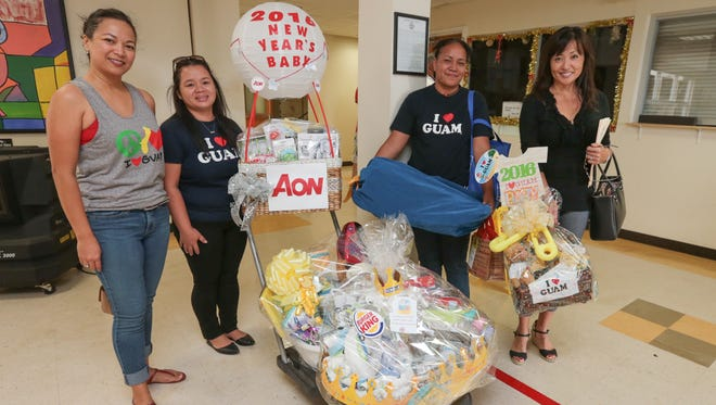 Representatives of I (Love) Guam, a division of Archway Incorporated, are photographed with the giveaway prizes at Guam Memorial Hospital on Jan. 1, 2016. The business each year gives gifts from local businesses to the family of the first child born in the new year. Rudy Capistrano/For PDN