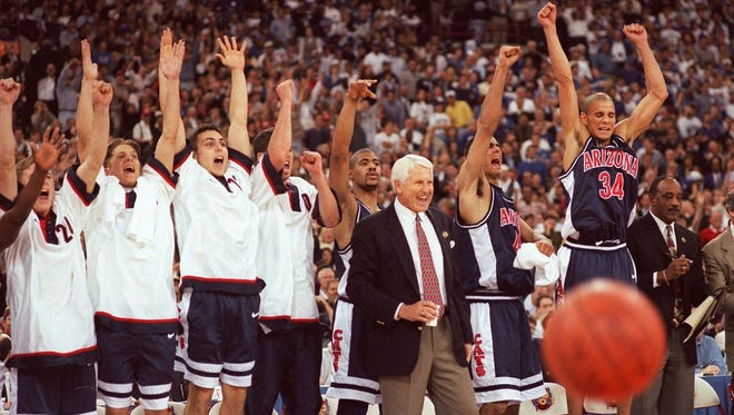 The Arizona bench and coach Lute Olson react during the Wildcats' NCAA title game against Kentucky in 1997.
