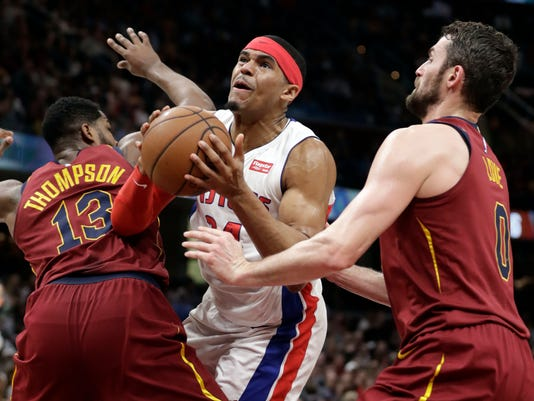 Detroit Pistons' Tobias Harris, center, drives between Cleveland Cavaliers' Tristan Thompson, left, and Kevin Love in the second half of an NBA basketball game, Sunday, Jan. 28, 2018, in Cleveland. The Cavaliers won 121-104. (AP Photo/Tony Dejak)