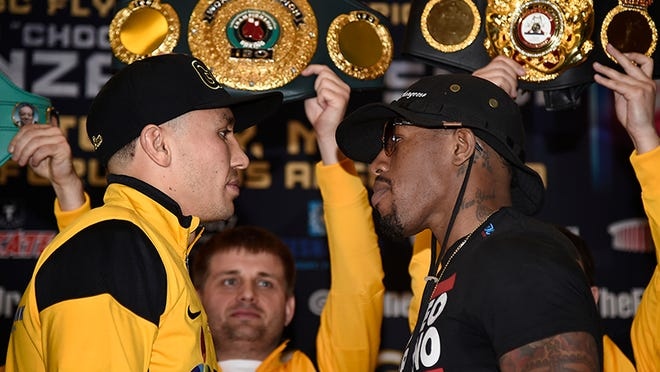 Willie Monroe Jr. (right) beat the odds to even secure a date with Gennady Golvokin. (Gene Blevins/Hogan Photos)
