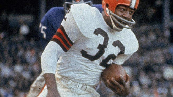 FILE - In this Nov. 14, 1965, file photo, Cleveland Browns running back Jim Brown (32) carries the ball during an NFL football game against the New York Giants in Cleveland. Jim Brown. Period. Arguably the greatest player in NFL history was picked by the Browns with the No. 6 overall pick in 1957. Brown rushed for 12,312 yards in nine seasons, leading the league in eight seasons. The three-time MVP walked away from his career at its peak to pursue acting.