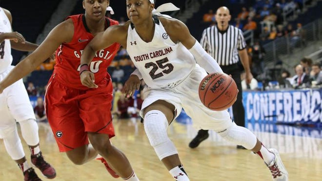South Carolina guard Tiffany Mitchell (25) drives against Georgia forward Shacobia Barbee (20) in the first half of a quarterfinal NCAA college basketball game in the women's Southeastern Conference.