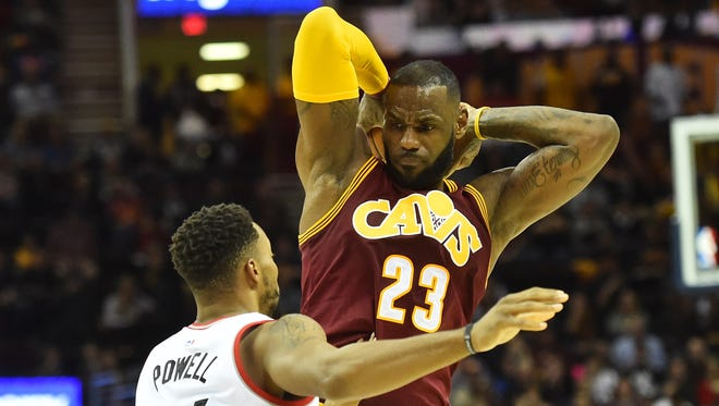 Cleveland Cavaliers forward LeBron James (23) holds the ball from Toronto Raptors guard Norman Powell (24) during the second quarter at Quicken Loans Arena.