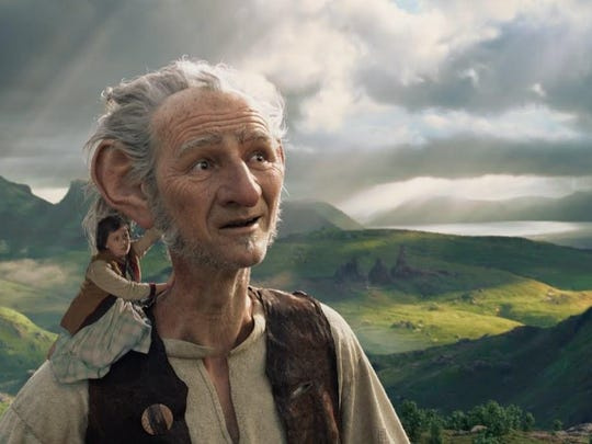 """Sophie (Ruby Barnhill) hitches a ride with the BFG (Mark Rylance) in Steven Spielberg's """"The BFG."""""""