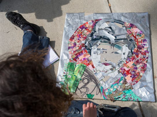 Shannon McKeon, Indianapolis, works up a piece of art