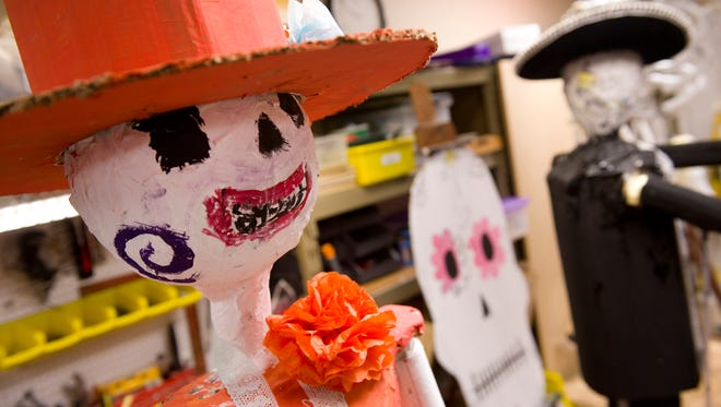 La Katrina, left, an ofrenda figure to be used in teacher Eric Ridenour's Day of the Dead class project, sits in a small wagon before Saturday's Day of the Dead festivities at Wesselman Park Nature Center this Saturday at 3 p.m.