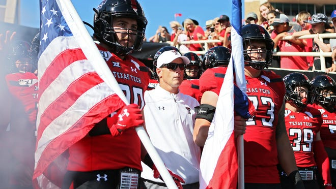 Texas Tech head coach Matt Wells lines up to runs onto the field prior to the game against Oklahoma State, Saturday, Oct. 5, 2019, at Jones AT&T Stadium in Lubbock, Texas.