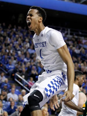 Kentucky Wildcats forward Skal Labissiere (1) reacts after dunking the ball against the Wright State Raiders in the first half at Rupp Arena.